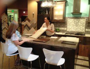 An interior designer and a new homeowner choose samples