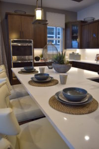 Cimmaron boasts a big, beautiful kitchen island that is the perfect size for enjoying a meal