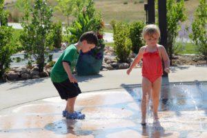 little kids in splash pad