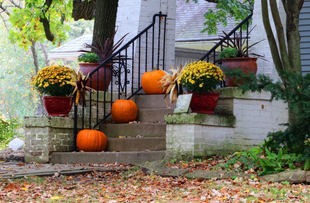 Main entrance stair and porch of the old house decorated for autumn holidays season. Halloween concept. Fall background.